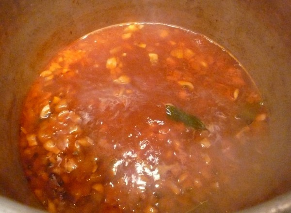 Simmer the fish Espagnole stock